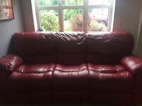 Two red leather Italian sofas