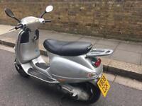 PIAGGIO VESPA ET4 silver 125cc normal wear & tear drives well!!