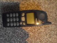 Very,very,very old Nokia mobile phone. The kind you see in old TV programmes.