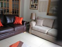 Stylish 3 seater fabric sofa with coordinating 2 seater leather sofa excellent immaculate condition.