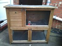 RABBIT/ GUINEA PIG TWO TEIR RABBIT HUTCH WITH FELT ROOF 12 MONTHS OLD