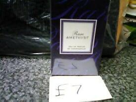 assortment of avon fragrances for her