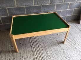 Play table with wheeled storage boxes that fit under the table