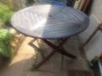 Good condition teak garden table (with 2 chairs if required)