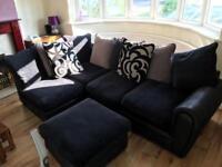 Black corner sofa and poufee