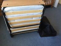 Single folding guest bed with headboard and cover. Used once. Buyer must collect please. £75