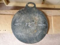 "Cast iron bake stone 12""."