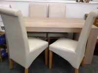 Nearly new Blonde Oak chunky legged solid table and 4 high back cream chairs