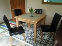 Table and 4 leatherette chairs....