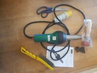 20- 650c heat gun for roofing membranes comes with roller,scissors, wire brush and nozzle used 1ns