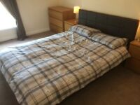 Immaculate double bed and new mattress. Mattress spotless as only used for 2 weeks.