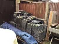 Reclaimed Grey Marley Bold Roll roof tiles, approx 450 available.