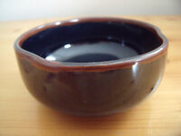 Attractive highly glazed dark blue/brown dish or pot with 'pinched' rim detail. £2.