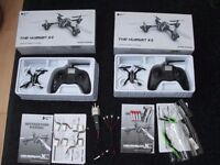 Two complete Husban X4 quadcopters with 8 new batteries.