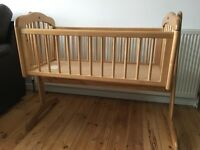 Wooden Rocking baby crib.
