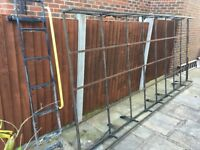 Heavy duty roof rack and rear door ladder from a Ford Transit