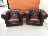 A Pair Of Brown Leather Chesterfield Club/Armchairs
