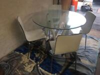 Stylish Table and for chairs good condition