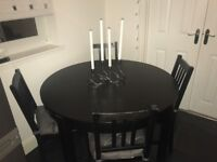 Expanding Round Table (seats 4-8) (Colour brown/black) + 4 chairs