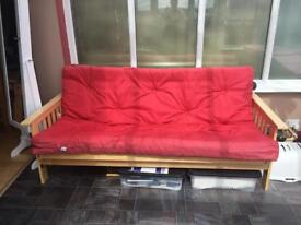 Lovely red, wooden sofa bed