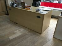 3 office desks, 2 with attached drawers, dismantled, Free.
