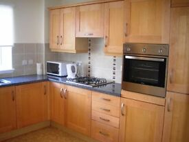 A two bedroom furnished flat with parking and communal gardens in Kings Road, Johnstone (ACT 87)