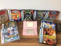 Pink nintendo ds with games inc mario