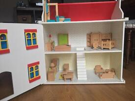 Wooden dolls house with beautiful wooden furniture