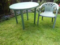 Green plastic garden table and 4 chairs