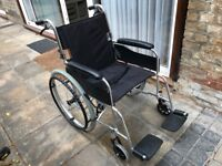 Wheelchair. Lightweight, folds away into car boot. Brakes on handles and wheels.