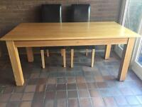 Lovely oak dining table and 6 leather effect chairs