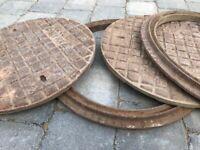 2 cast iron circular drain covers