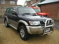 Nissan Patrol Gr 3.0 Di SE 7 seater in blue with grey leather trim. W reg year 2000.