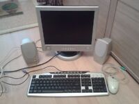 "Desktop bits inc a nice Hansol 15"" silver monitor, pair of speakers, keyboard & mouse"