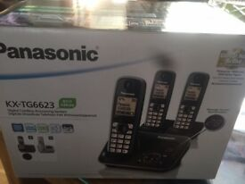Brand New in box , Panasonic telephone with triple handsets and answer machine