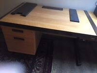 Three office desks, two with drawers.