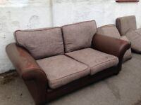 LARGE TWO SEATER LEATHER AND FABRIC SOFA IN GOOD USED CONDITION SOME SIGNS OF USE BUT CLEAN