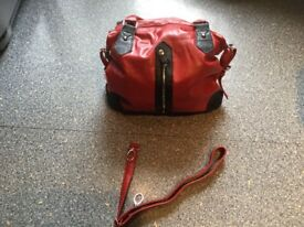 BRAND NEW blood red and black bag 2 zip pockets outside & 2 larger zip inside. Great for hols etc.