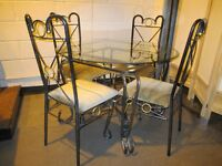 BLACK AND GOLD WROUGHT IRON GLASS TOP DINING TABLE WITH FOUR MATCHING DINING CHAIRS FREE DELIVERY