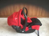 Car seat with footmuff and rain cover