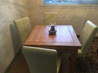Solid wood oak table 4/6 seater with 4 dining chairs