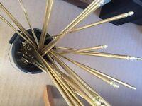 Gold coloured carpet rods