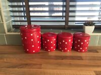 Next red and white polka dot canisters and matching biscuit jar