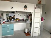 IKEA high bed with desk and wardrobe.
