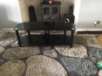 Black glass TV stand excellent condition only selling because our new TV is Too big