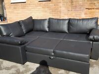 Fabulous Brand New black leather corner sofa bed with storage. can deliver