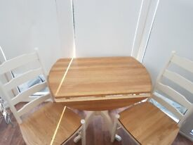 John lewis Solid wood table and 2 chairs cost 679.00...brand new ...................................