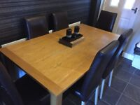 Solid wood table and 6 brown leather chairs great condition