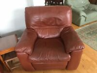 Leather sofa : 1 two seater and 1 electric reclining arm chair for sale.