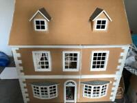 Wooden dolls house and collectible furniture